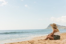Woman In Hat Relaxing In The Beach