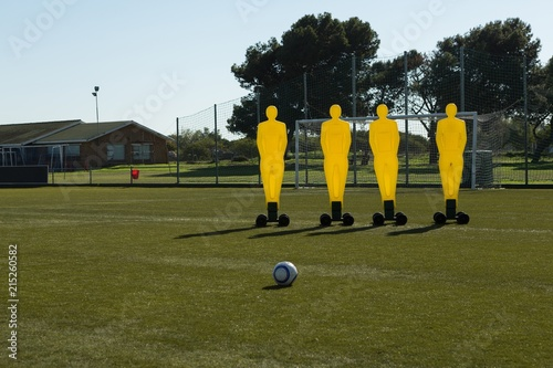 Football training equipment and soccer ball in field