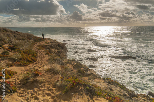 Foto op Aluminium Kust Walking girl by Atlantic ocean coast, hiking, sport, Portugal