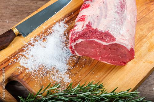 Slika na platnu Raw whole beef scotch fillet on chopping board