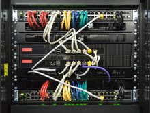 Detail Of A Communications Rack, Cables, Switches And Network