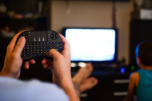 The Mini Black Keyboard In The Living Room Is Used For The Use Of Various Interesting Content, Connecting The Device In The Afternoon Relaxing Atmosphere In The Home.