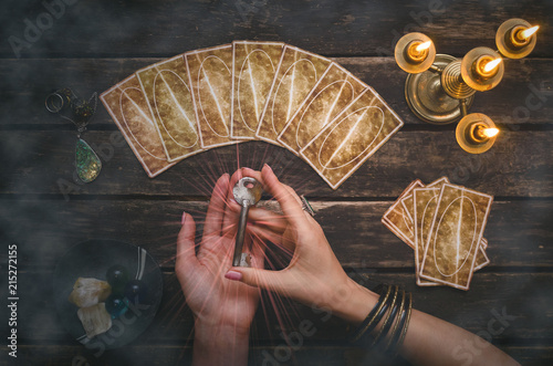Tarot cards on fortune teller desk table background Canvas Print
