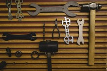 Various Work Equipment Hanging On Wooden Wall