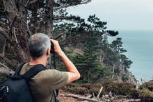 Backpacker Man Looking At The Ocean