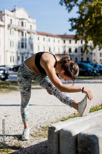 Sporty woman during workout in the city