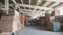 Warehouse With Stacked Wood In...