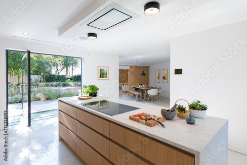 View Of Modern Kitchen Counter Looking Through To Dining Area Glass