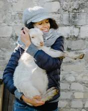 Woman Hugging Goat