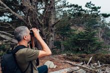 Backpacking Hiker Looking Through Binoculars