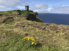 Expansive View Of Shoreline From The Cliffs Of Moher, Medieval Castle In Distance, Ireland