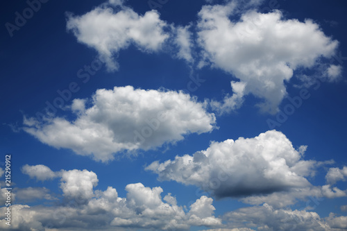 Cumulus clouds in blue sky on a sunny day at noon, Bavaria, Germany