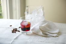 Summer Cocktail By Ice Bucket With Almonds And Cloth Napkin