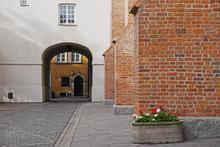 Planter By Brick Wall And Passage Through Building, Stare Miasto, Warsaw, Poland