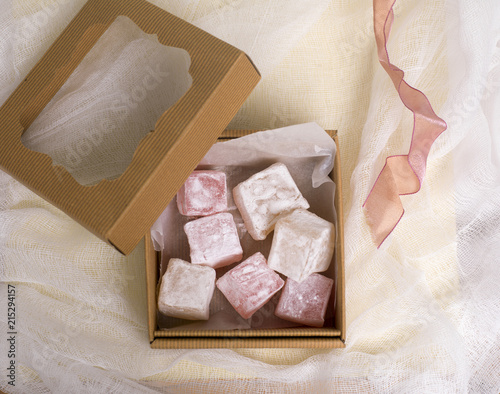 Keuken foto achterwand Snoepjes Overhead View of Open Gift Box of Turkish Delight with Ribbon