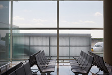 Airport Hall With Empty Seats And Big Window With A View