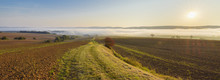 Countryside With Pathway And Morning Mist Over The Fields At Sunrise In The Community Of Grossheubach In Bavaria, Germany