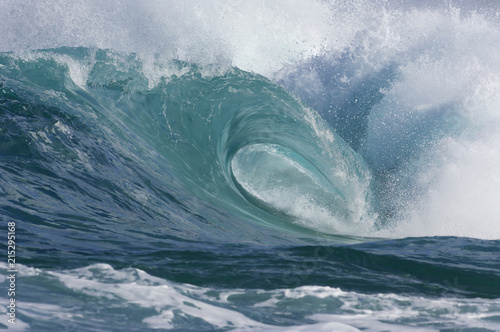 Crest of breaking wave at the North Shore of Oahu in Hawaii, USA