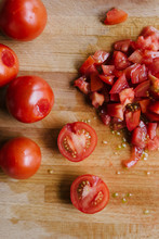 Vine Ripened Tomatoes Chopped On A Cutting Board