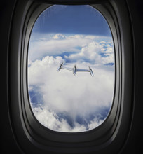 View Of Approaching UFO From Airplane Window