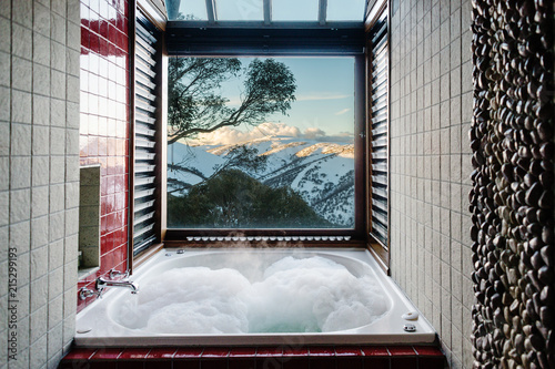 bathroom with spa bath and view to snow covered mountains