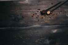 Spices In Wooden Spoons On A Wooden Background. Colorful Spices In Wooden Spoons