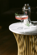 Pink Coloured Cocktail On A Sunlit Marble Table