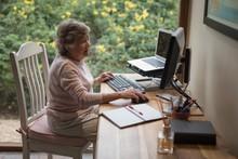 Senior Woman Using A Desktop Computer