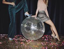 Women Posing With Disco Ball