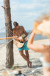 selective focus of man playing acoustic guitar with girlfriend on foreground