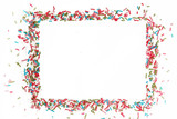 Fototapeta Tęcza - White paper with colorful sprinkles around, party design element. Festive holiday background with copy space. Celebration concept.