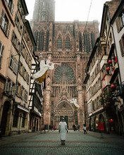 Woman Standing At Old Cathedral