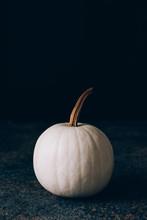 White Pumpkins With Golden Stem On Dark Background