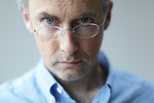 Man With Stern Look Over His Glasses