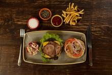 Meat Burger With French Fries On Wooden Table