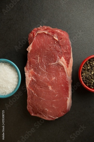 Meat with species on concrete background