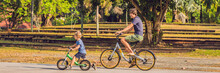 Happy Family Is Riding Bikes Outdoors And Smiling. Father On A Bike And Son On A Balancebike BANNER, Long Format