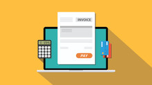 Online Invoice Technology With Laptop And Paper Work Document