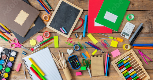 Fotografía Back to school. School supplies on wooden background, top view
