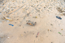 Many Types Of Garbage Near The Sea.