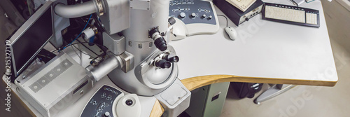 transmission electron microscope in a scientific laboratory BANNER, long format
