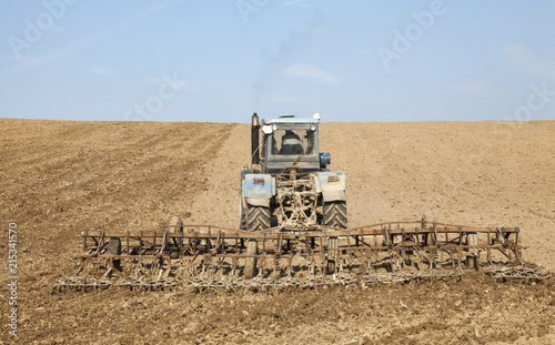 Fotografia, Obraz Harrowing the soil with tine harrows