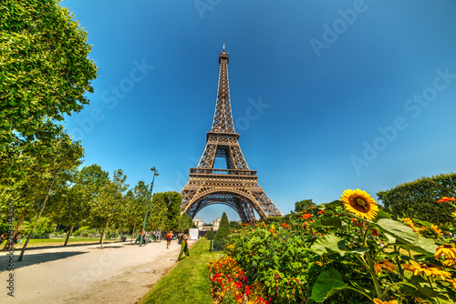 Tourists by world famous Eiffel tower in Paris