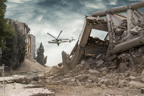 View on a collapsed concrete industrial building with an attack helicopter Mi24 Fotobehang