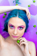 Portrait of young pretty female girl adult woman / fashion luxury model with blue hair relaxing in bathtub isolated by pink water with green leaves and plants. Organic skin care, beauty and body care