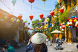 Leinwanddruck Bild - Tourist is walking in Old town in Hoi An, Vietnam.