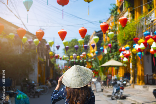 Tourist is walking in Old town in Hoi An, Vietnam. Wallpaper Mural
