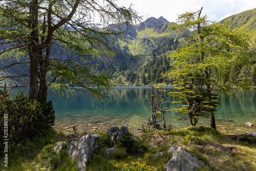 mountain lake scheibelsee, in the background mountain great boesenstein in styria, rottenmanner tauern, austria