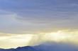 cloudy sky over silhouette of mountain range in Mojave Desert