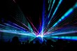 canvas print picture - Colorful laser show nightlife club stage with party people crowd. Luxury entertainment with audience silhouettes in nightclub event, festival or New Year's Eve. Beams and rays shining colorful lights